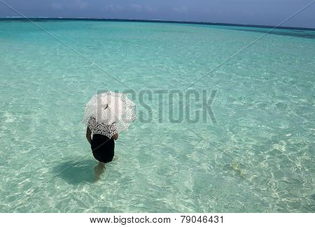Woman With White Lace Umbrella Standing In The Ocean