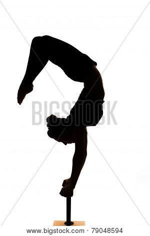 Caucasian Woman Contortionist Practicing Gymnastic Yoga In Silhouette