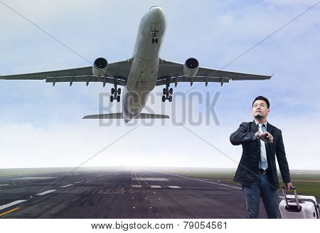 Young Business Man Standing In Airport Runways With Belonging Luggage Lookin To Time Watch And Sky A