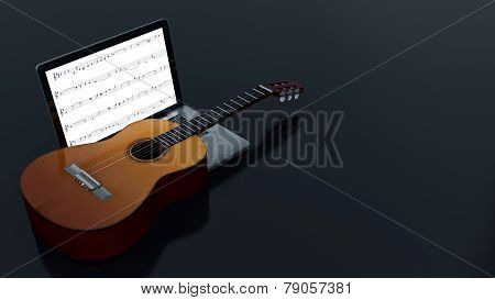 computer with acoustic guitar