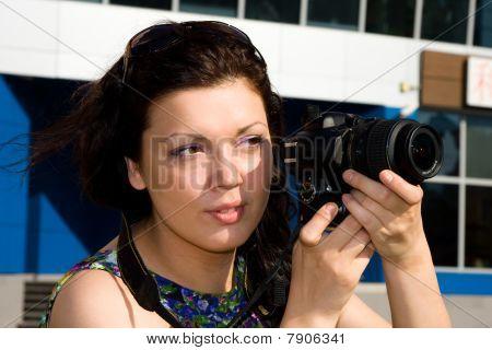 Female Photographer Takes A Photo