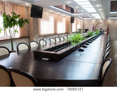A large table and chairs in a modern conference room.