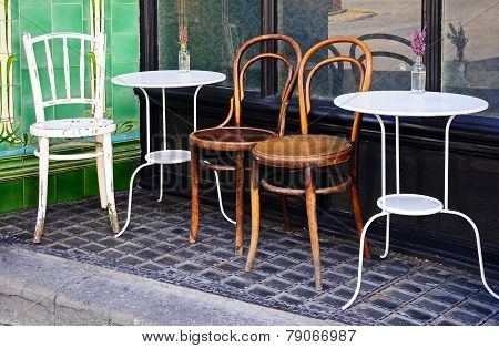 Rustic cafe tables and chairs.