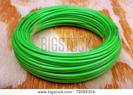 Trimmer line string of grass cutter on the wooden table poster