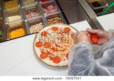 Pizza maker at commercial kitchen