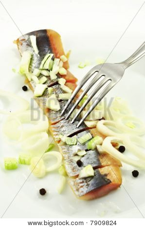 Salted herring on the plate