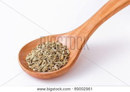 Fennel Seeds In A Wooden Spoon - Spoon Diagonally
