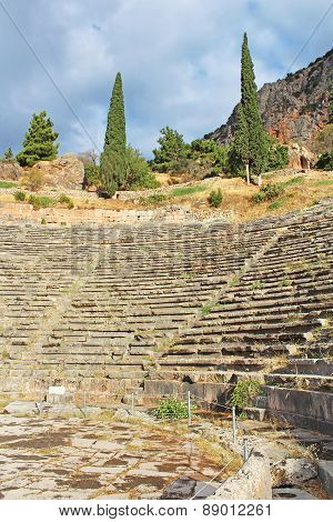 Ancient Theatre Delphi, Greece. The ancient theatre at Delphi was originally built in the 4th century BC, but was remodeled on several occasions since poster