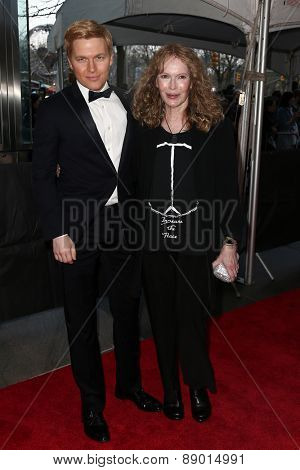 NEW YORK-APR 21: TV personality Ronan Farrow (L) and mother actress Mia Farrow attend the 2015 Time 100 Gala at Frederick P. Rose Hall, Jazz at Lincoln Center on April 21, 2015 in New York City.
