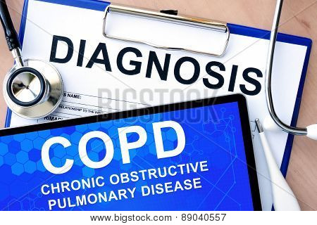 Form with word diagnosis and tablet with Chronic obstructive pulmonary disease (COPD) poster