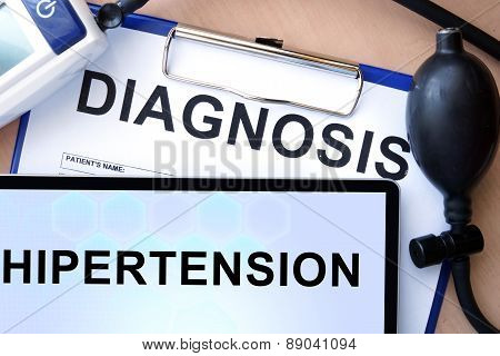 Tablet with hypertension, form with word diagnosis