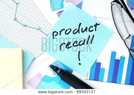 Papers with graphs, glasses and Product Recall concept.