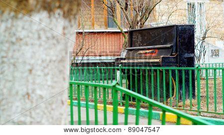 Old pianoforte left outdoors