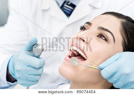 Female Getting Her Teeth Examined