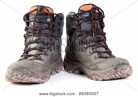Pair of Dirty Boots Isolated on white background.