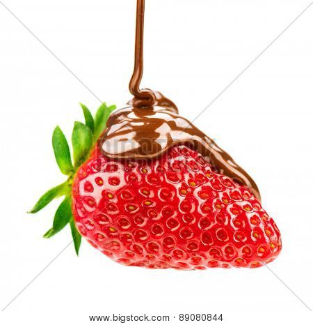 Strawberry in chocolate isolated on white background. Melted Chocolate pouring on fresh ripe juicy strawberry close up. Dessert. Gourmet food. Fondue