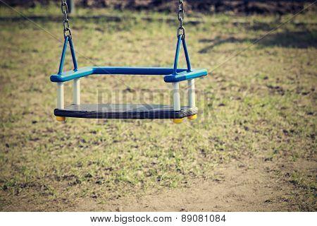 Children's Swing On Chains In Kindergarten