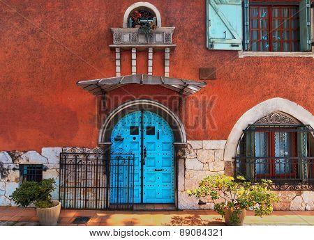 Traditional european vivid facade with entance door poster
