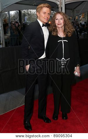 NEW YORK-APR 21: Ronan Farrow (L) and mother Mia Farrow attend the 2015 Time 100 Gala at Frederick P. Rose Hall, Jazz at Lincoln Center on April 21, 2015 in New York City.
