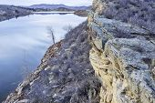 winter dusk over mountain lake with sandstone cliffs - Horsetooth Reservoir near Fort Collins, Colorado poster