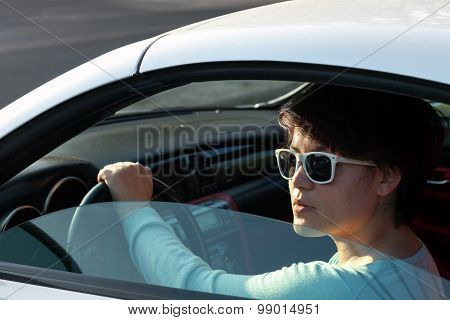 Woman Driving a Sports Car