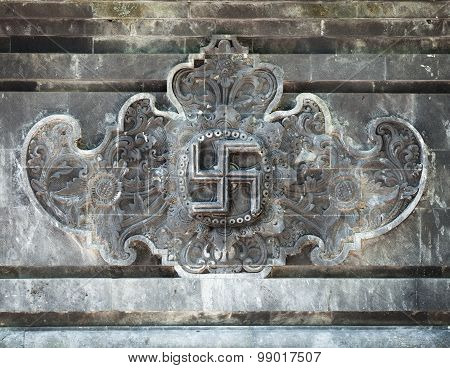 Beautiful hand-carved relief depicting a symbol for good luck inside Goa Lawah Bat Cave Temple in Bali Indonesia. poster