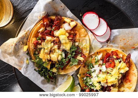 mexican al pastor street tacos overhead shot close up