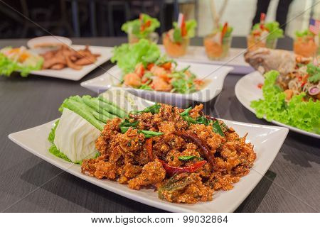 Thai cuisine spicy crispy pork salad Larb with spicy salmon and grill pork