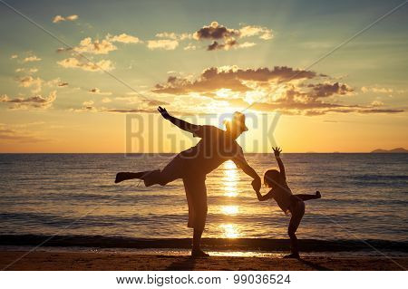 Father And Son Playing On The Beach