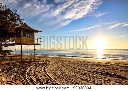 Lifeguard patrol tower on the beach at sunrise