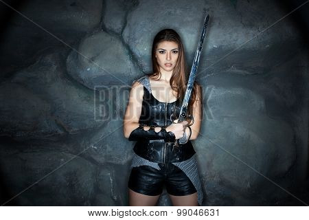 Girl In Leather Dress With A Sword His Hand.