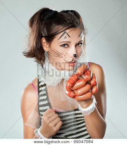 Girl With Cat Muzzle In His Hand Holding Sausages.