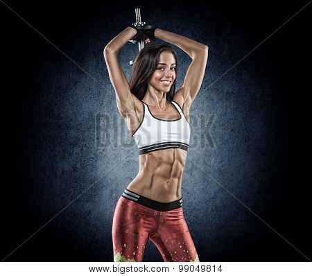 Sports Young Woman With Dumbbells