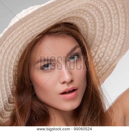Beautiful girl with broad-brim