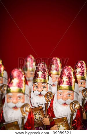 Close-up of Sinterklaas. Saint  Nicholas chocolate figures of  Dutch character of Santa Claus. Vignette added