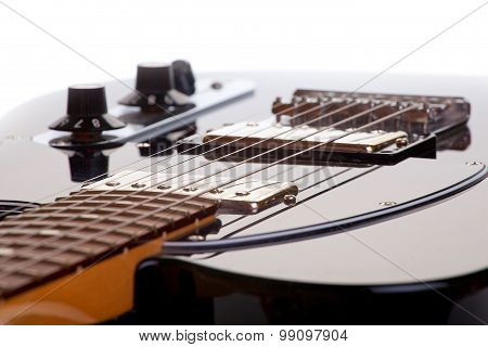 Black Electric Guitar Strings On A White Background