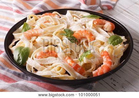 Pasta Alfredo In Cream Sauce With Shrimp Close-up. Horizontal