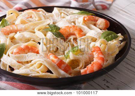 Italian Pasta Fettuccine In A Creamy Sauce With Shrimp Closeup. Horizontal
