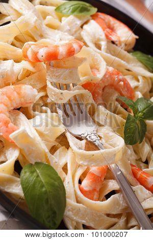 Fettuccini Pasta In Cream Sauce With Shrimp Macro. Vertical