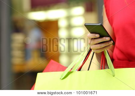 Shopper Shopping With A Smart Phone