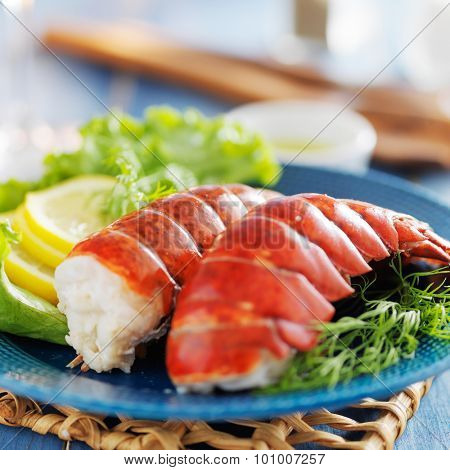 lobster dinner with lemon and lettuce garnish