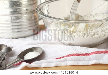 Flour, butter, sugar with vintage baking equipment