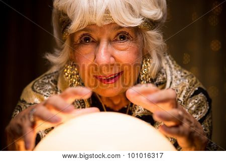 Old fortune teller is strange with her crystal ball poster