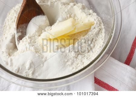 Combining butter with flour and sugar