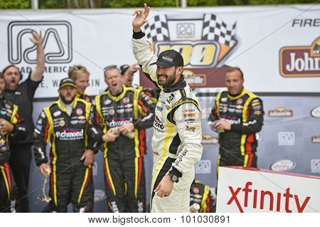 Elkhart Lake, WI - Aug 29, 2015:  Paul Menard (33) celebrates in victory lane after winning the Road America 180 in the Richmond/Menards Chevy at Road America in Elkhart Lake, WI.