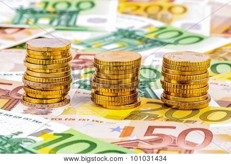 three stacks of money coins photo icon for financial planning, investments and interest income