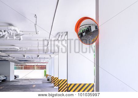 Traffic convex mirror for safety at car park.