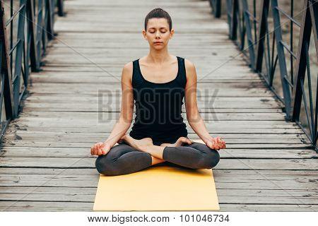 young slim woman doing yoga