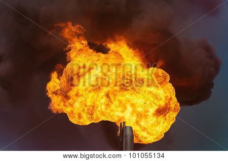 Flame of an oil torch against the night sky poster
