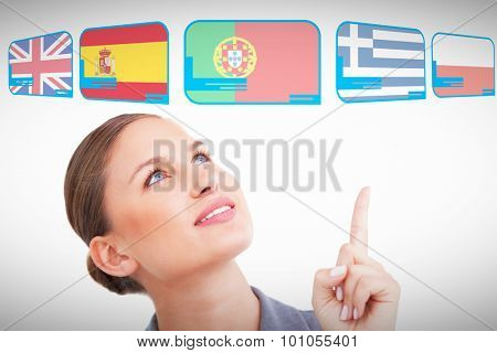 Close up of tradeswoman looking and pointing up against white background with vignette